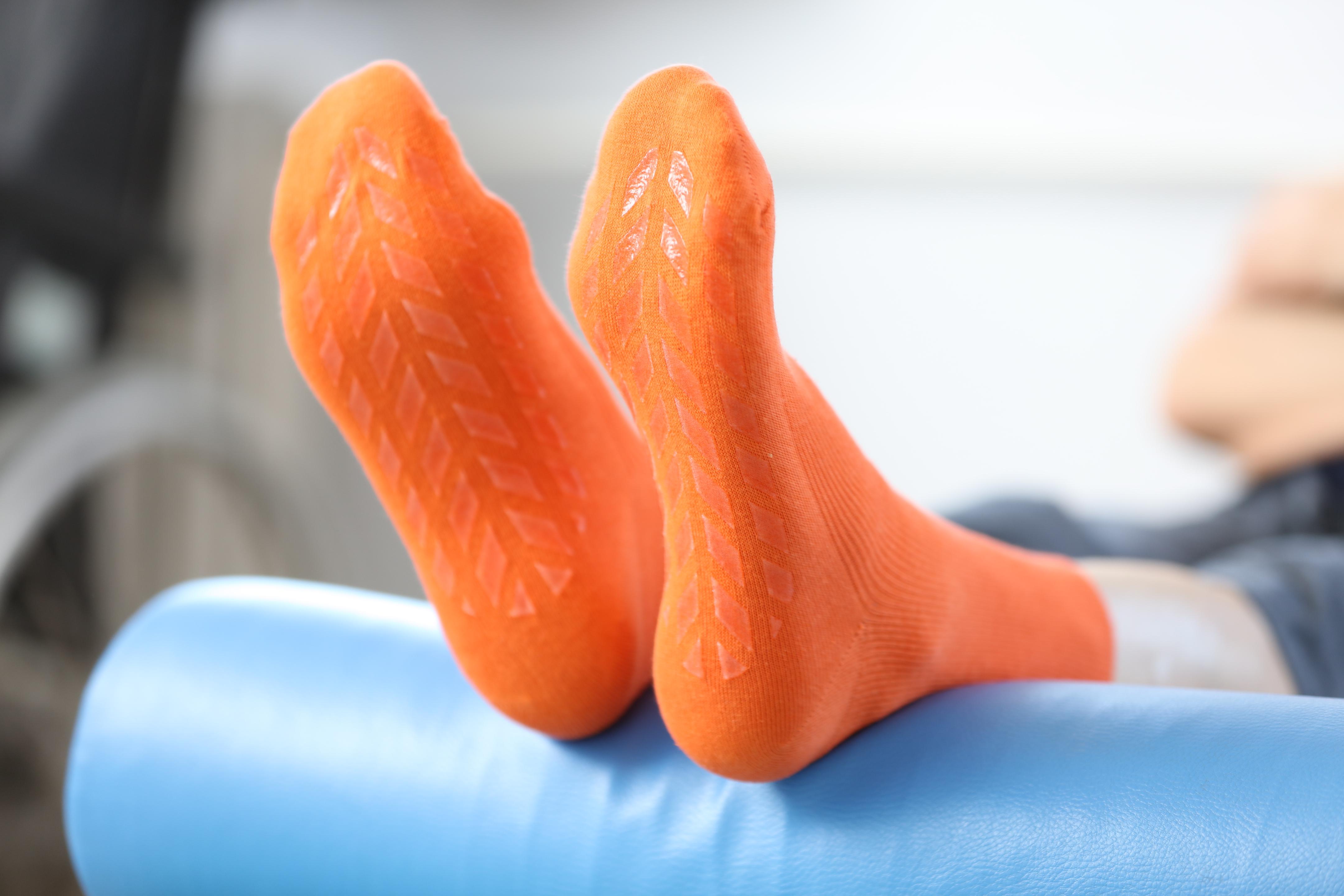 Orange socks – non-binding socks with an ABS grip.